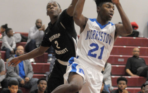 Gene Walsh — Digital First Media Norristown's Darius Hopewell looks to pass as McDevitt's Kyle Hines defends during the Triangle Tournament at Montgomery County Community College December 29, 2017.