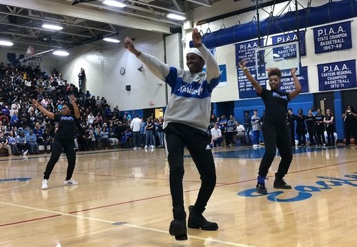 From left, JaLisa Gibson, Matthew McCray, and La Brea Johnson, members of NAHS step team, pump up the crowd at the Winter pep rally.