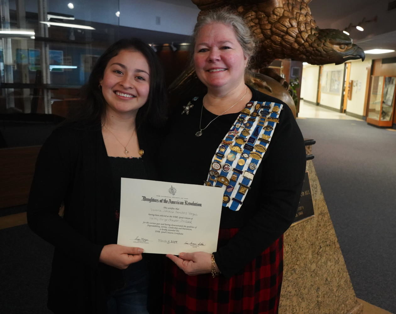 Valeria Sanchez (left) accepts the Daughters of the American Revolution Good Citizen Award.