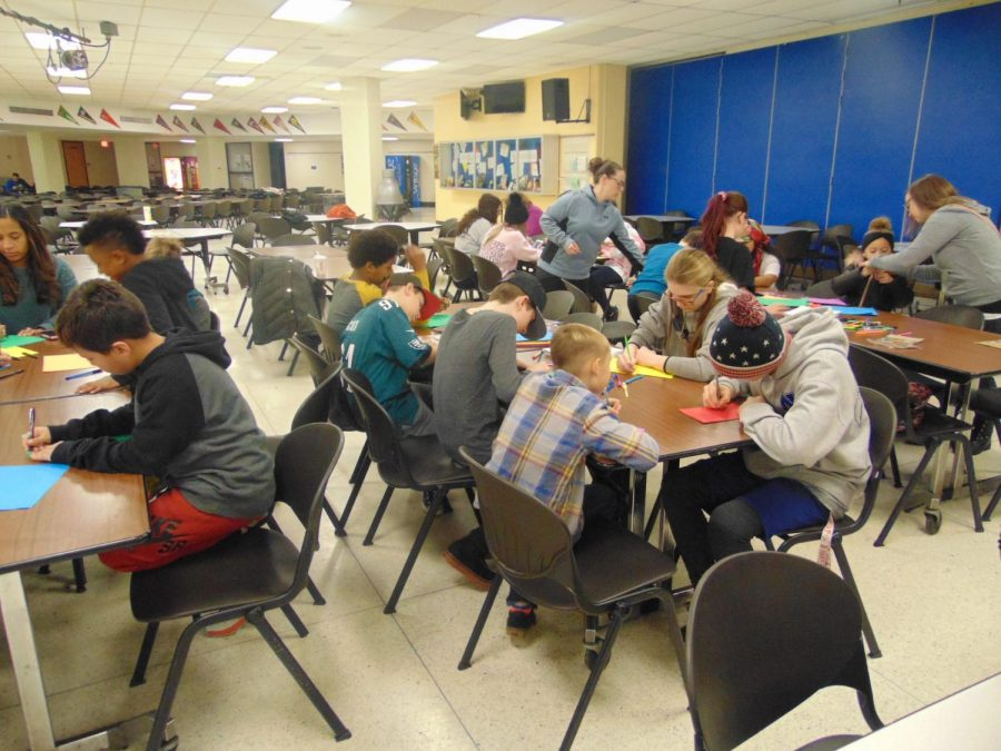 Volunteers write letters to veterans on Martin Luther King Jr. Day of Service.