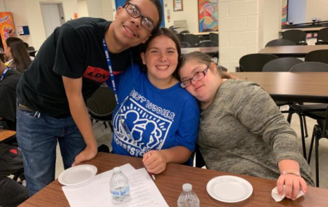 Ryan, Rachel, and Ana celebrate a fun time together in the lunch room.